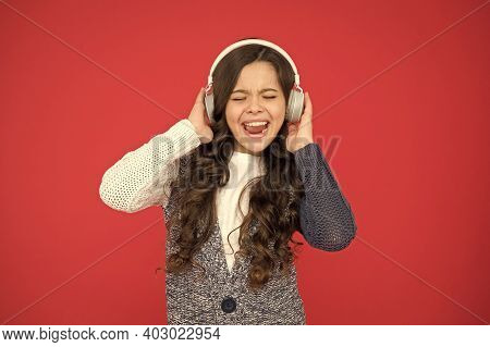 Life Is Song, Sing It. Happy Child Sing Song Red Background. Little Girl Listen To Song In Headphone