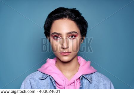 Confident Stylish Cool Gen Z Teen Girl, Short-haired Zoomer Teenager With Trendy Pink Makeup On Pret