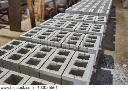 Industrial Production Of Building Materials From Pressed Cement Mortar. High Quality Hollow Concrete