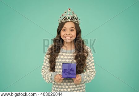 Portrait Of Cute Smiling Little Girl With Gift Box. Kid In Princess Crown. Happy Birthday Daughter.