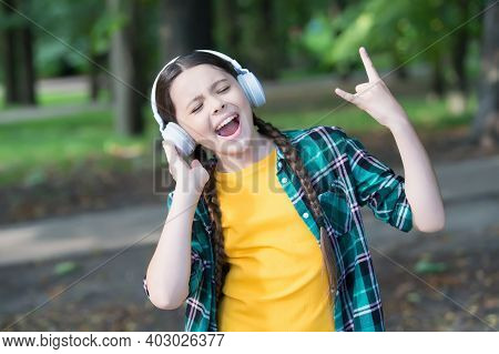 Lets Rock. Happy Kid Show Horns Hand Gesture. Singing Along To Music. Listen Technology. Modern Life
