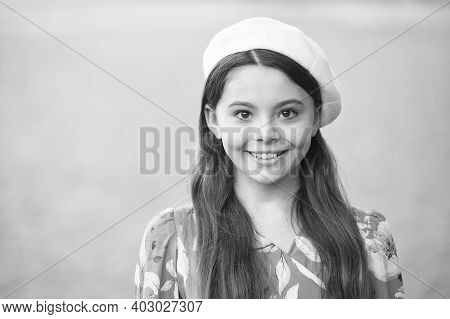 French Fashion Icon. Happy Kid Wear French Beret Grey Background. French Look Of Little Girl. Small