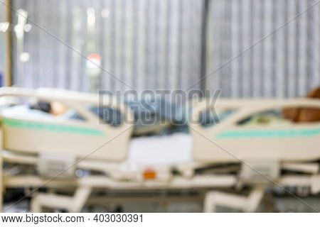 Blur Image Background Of Patient Lie Convalesce On Bed At Recovery Sterile Room In Hospital