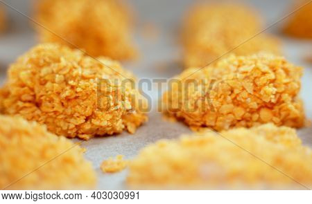 Chicken Nuggets On Parchment Paper Before Baking.