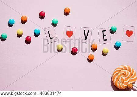 Pink Candies, Lollipops And Jelly Beans On Pink Background. Sweet Greeting Card. Pastry Shop. Top Vi