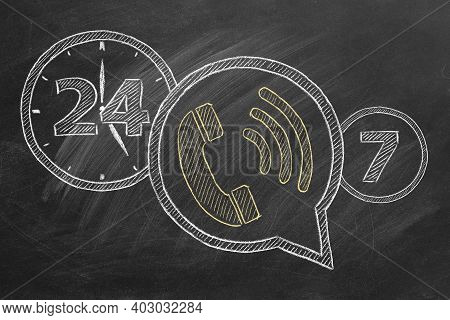 Phone Icon With Lettering 24-7 Drawn In Chalk On A Blackboard. Contact Center, Call Center, Service