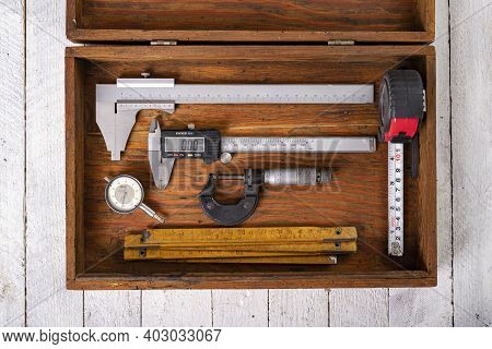 Measuring Tools In A Wooden Case. Accessories For Engineers To Take Measurements.