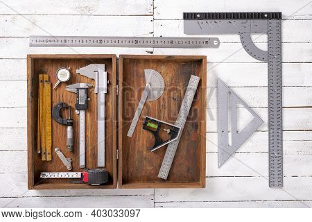 Measuring Tools In A Wooden Case And On A Table. Accessories For Engineers To Take Measurements.