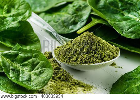 Dry Spinach Powder On White Background. Green Powder. Could Be Any Green Super Food. Perhaps Spiruli