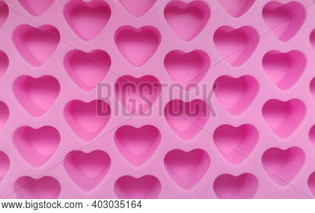 Silicone Confectionery Mold Made Of Silicone In The Form Of Small Pink Hearts Close-up.