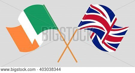 Crossed And Waving Flags Of Ireland And The Uk. Vector Illustration