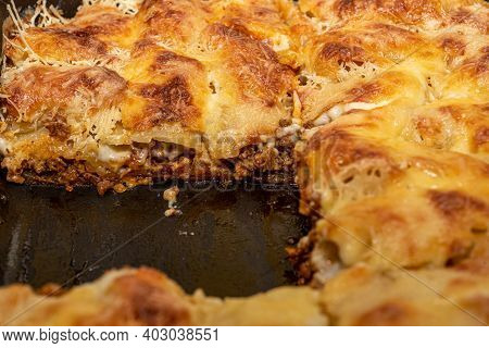 Soft Focus. Close-up Of Cooked Lasagna Sliced Into Portions. Layers Of Lasagna. Food Background.