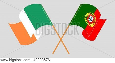 Crossed And Waving Flags Of Ireland And Portugal. Vector Illustration