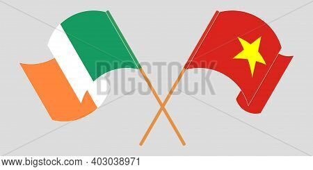 Crossed And Waving Flags Of Ireland And Vietnam. Vector Illustration