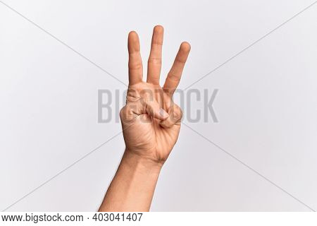 Hand of caucasian young man showing fingers over isolated white background counting number 3 showing three fingers