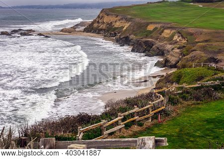 Golf Course Putting Green And Cliffs By The Pacific Ocean Bay. Half Moon Bay California. Villas And
