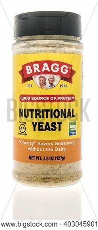 Winneconne, Wi -9 January 2021: A Package Of Package Of Bragg Nutritional Yeast On An Isolated Backg