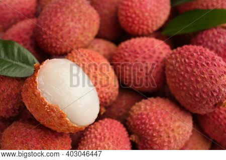 Pile Of Fresh Ripe Lychees With Leaves As Background, Closeup