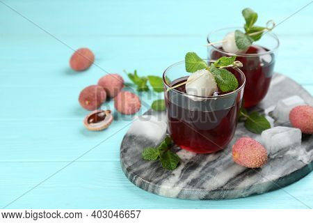 Lychee Cocktail On Cyan Wooden Table, Space For Text