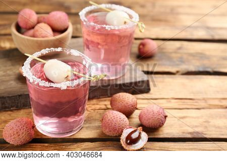 Lychee Cocktail And Fresh Fruits On Wooden Table, Space For Text
