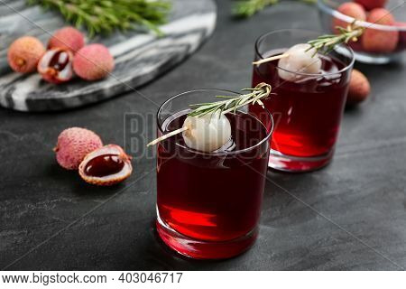 Delicious Lychee Cocktails With Rosemary And Fresh Fruits On Black Table