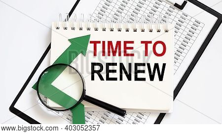 Notebook With Tools And Notes About Time To Renew With Chart,