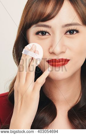 Makeup Beauty Asian Woman Applying Powder Foundation On Face.