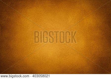 Dark Orange Matte Background Of Suede Fabric With Vignette, Closeup. Velvet Texture Of Seamless Gold