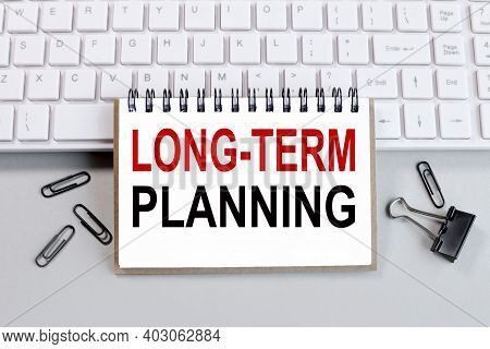 Long Term Planning, Text On White Notepad Paper. On White Keyboard Background