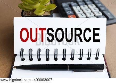 Outsource, Text On White Paper On Calculator And Plants Background