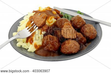 Beef Meatballs And Mashed Potato Meal With Green Beans And Gravy Isolated On A White Background