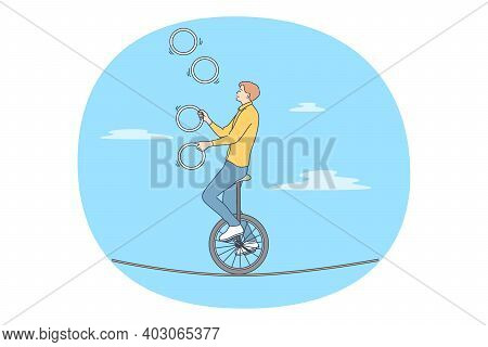 Acrobat, Performer, Challenge Concept. Young Man Acrobat Circus Artist Riding On Bike On Rope And Ju
