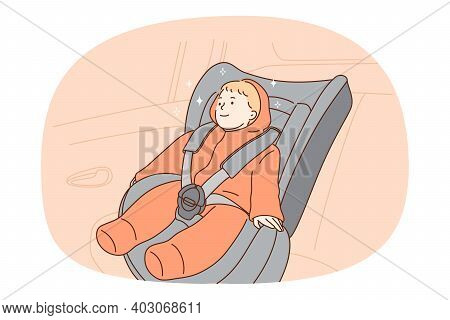 Car Seat For Toddler Protection Concept. Small Smiling Baby Kid Toddler Sitting In Special Car Seat