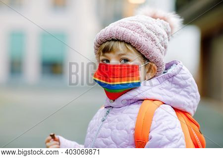 Little Kid Girl Wearing Medical Mask On The Way To Kindergarten, Playschool Or Nursery. Child With B
