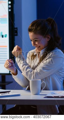 Excited Woman Feel Ecstatic Reading Great Online News On Laptop Working Overtime In Start Up Company