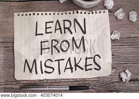 Learn From Mistakes, Text Words Typography Written On Book Against Wooden Background, Life And Busin