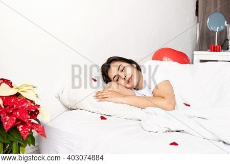 Young Brunette Woman Sleeping In The Bed With Red Heart Shaped Balloons And Decorations
