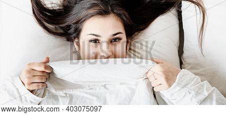 Young Beautiful Brunette Woman Sleeping In Bed