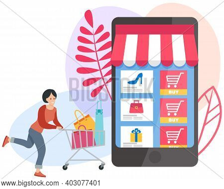 Satisfied Woman Smiles And Stands With Shopping Cart Full Of Purchases, Online Shopping Concept. Car