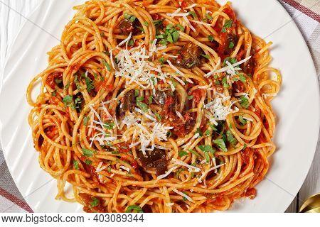 Pasta Spaghetti Alla Norma On A White Plate On A White Textured Wooden Table, Italian Cuisine, Horiz