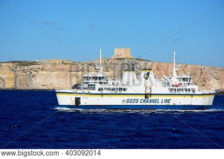 Gozo, Malta - April 3, 2017 - Ta Pinu Gozo Channel Line Ferry With Views Towards Comino To The Rear