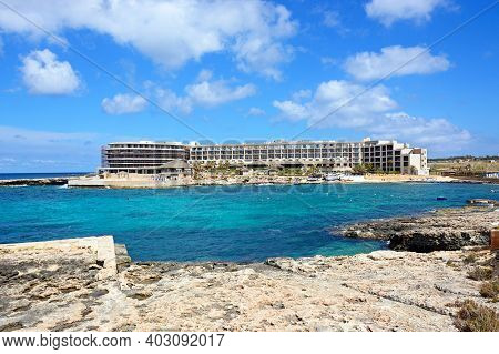 Ramla Bay, Malta - April 2, 2017 - View Of Ramla Bay Resort Hotel And Beach With The Rocky Shoreline
