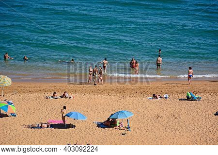 Albufeira, Portugal - June 6, 2017 - Elevated View Of The Beach With Tourists Enjoying The Setting,