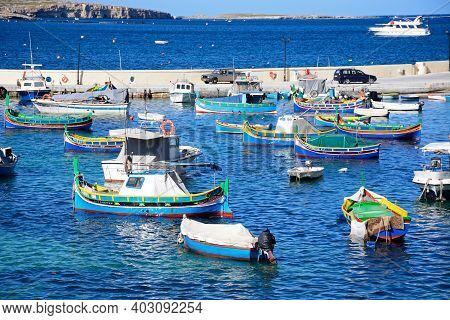 San Pawl, Malta - April 2, 2017 - Traditional Maltese Dghajsa Fishing Boats Moored In The Harbour Wi
