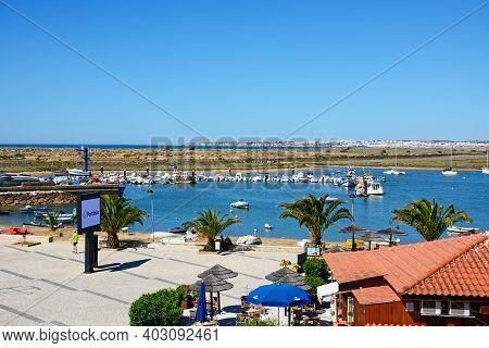 Alvor, Portugal - June 7, 2017 - Elevated View Of A Riverside Restaurant With Views Across The Estua
