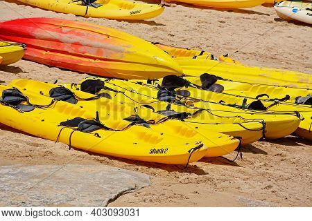 Lagos, Portugal - June 9, 2017 - Yellow And Orange Kayaks On The Beach, Lagos, Algarve, Portugal, Eu