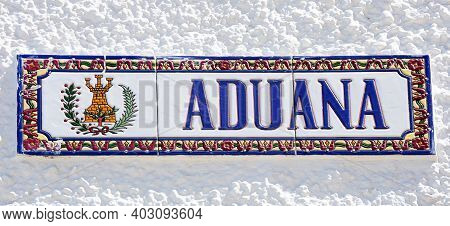 Ayamonte, Spain - June 11, 2017 - Ceramic Customs (aduana) Sign On A Building Along The Waterfront,