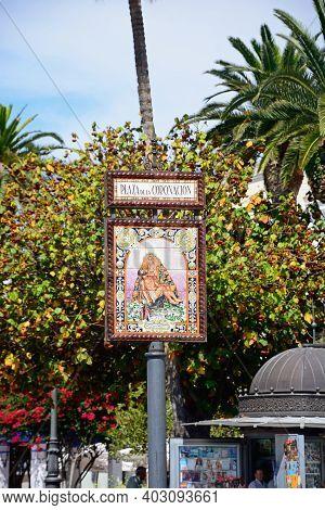 Ayamonte, Spain - June 11, 2017 - Ceramic Sign Depicting Mary Holding The Crucified Jesus, Coronatio
