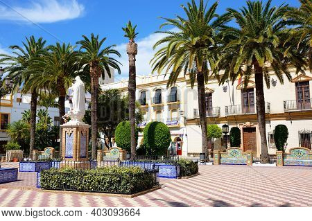 Ayamonte, Spain - June 11, 2017 - Statue In The Plaza De La Laguna With The Town Hall To The Rear, A