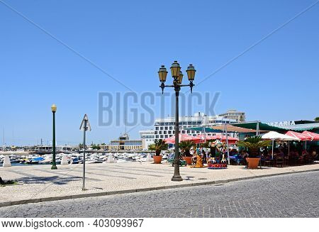 Faro, Portugal - June 12, 2017 - Pavement Cafes On The Waterfront With The Marina To The Rear, Faro,